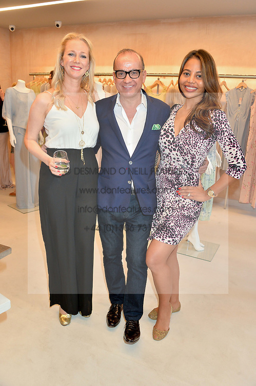 Left to right, GEORGINA COWAN, TOUKER SULEYMAN and VISCOUNTESS WEYMOUTH at a party to celebrate the re-launch of the Ghost Flagship store at 120 King's Road, London on 15th April 2015.
