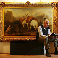 Sothebys Auction at Gleneagles...<br /> One of the highlights of this years sale is 'The Halt' by John Frederick Herring dated 1852 and shows a party of two highlanders, their ponies and a pair of deerhounds pausing by a burn...The painting is expected to reach in excess of £300,000 - £500,000, Pictured with the painting is Sotheby's Scottish Director Harry Robertson<br /> Picture by Graeme Hart.<br /> Copyright Perthshire Picture Agency