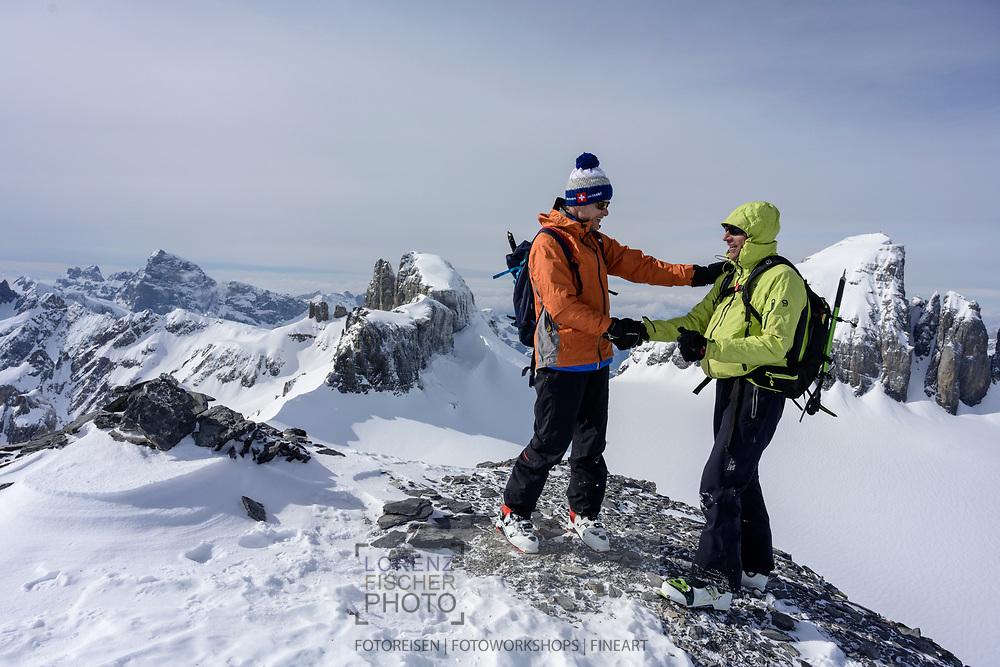 On the summit of mount Zwächten on a ski tour from the Meiental on mount Zwächten with a descent to the Erstfeld valley, Uri, Switzerland<br /> <br /> Skitour vom Meiental auf den Zwächten mit Abfahrt ins Erstfelder Tal, Uri, Schweiz