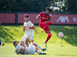LIVERPOOL, ENGLAND - Wednesday, September 15, 2021: Liverpool's James Balagizi (R) jumps away from a rash challenge from AC Milan's Andrei Coubis during the UEFA Youth League Group B Matchday 1 game between Liverpool FC Under19's and AC Milan Under 19's at the Liverpool Academy. Liverpool won 1-0. (Pic by David Rawcliffe/Propaganda)