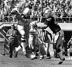 Green Bay Packers Fred Carr intercepts pass intended for Raider Pete Banaszak..(1970 photo/Ron Riesterer)
