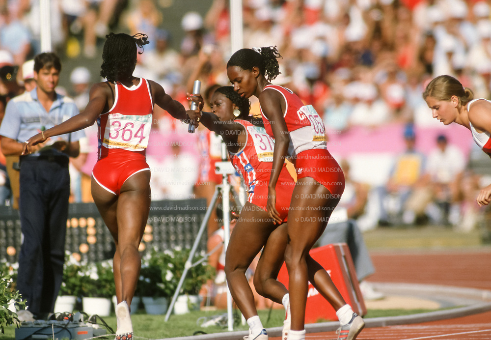 LOS ANGELES -  AUGUST 11:  Valerie Brisco-Hooks #364 of the United States hands off to teammate Chandra Cheeseborough #378 during the Women's 4 x 400 meter relay event of the track and field competition of the 1984 Olympic Games on August 11, 1984 at the Los Angeles Coliseum in Los Angeles, California.     (Photo by David Madison/Getty Images)