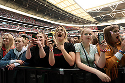 Fans during Capital's Summertime Ball. The world's biggest stars perform live for 80,000 Capital listeners at Wembley Stadium at the UK's biggest summer party. PRESS ASSOCIATION PHOTO. Picture date: Saturday June 8, 2019. Photo credit should read: Isabel Infantes/PA Wire.