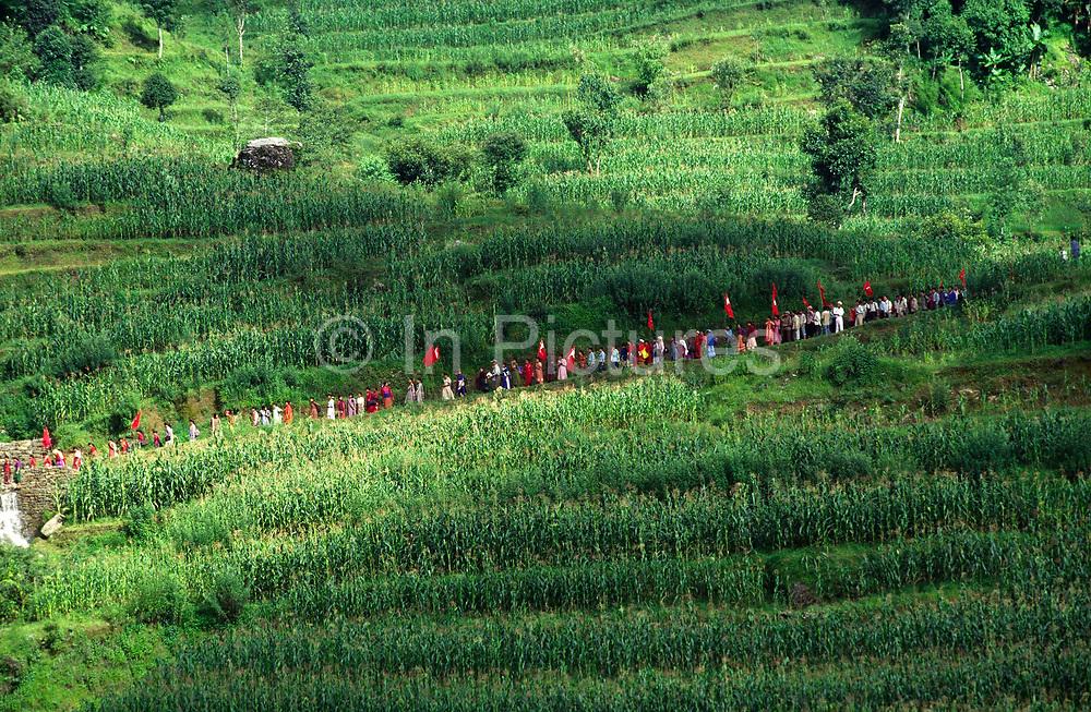 Peasants walk to a Maoist rally in Dolakha, Nepal