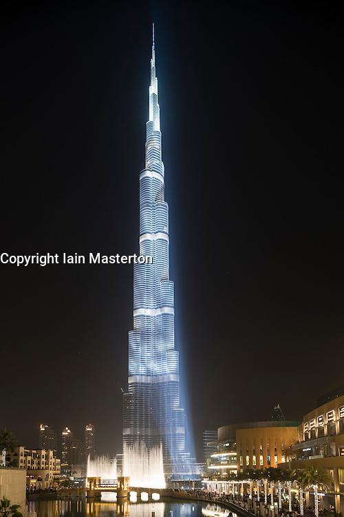 Night view of floodlit Burj Khalifa Tower in Dubai United Arab Emirates
