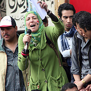 A veiled woman passionately rallies the crowd during the Day of Justice and Cleansing in Cairo's Tahrir Square.