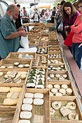 People shopping for artisan cheese on sale at street market Bordeaux, France