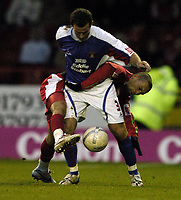 Photo: Jonathan Butler.<br />Swindon Town v Carlisle United. The FA Cup. 11/11/2006.<br />Christian Roberts of Swindon tackles Peter Murphy of Carlisle.