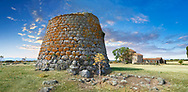 Picture and image of the Byzantine Romanesque church of Santa Sabina and the prehistoric Nuragic ruins of Nuraghe Santa Sabina, archaeological site, Middle Bronze age , Silanus ,  Sardinia. .<br /> <br /> If you prefer you can also buy from our ALAMY PHOTO LIBRARY  Collection visit : https://www.alamy.com/portfolio/paul-williams-funkystock/nuraghe-santa-sabina-sardinia.html<br /> Visit our PREHISTORIC PLACES PHOTO COLLECTIONS for more   photos  to download or buy as prints https://funkystock.photoshelter.com/gallery-collection/Prehistoric-Neolithic-Sites-Art-Artefacts-Pictures-Photos/C0000tfxw63zrUT4