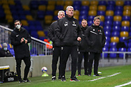 AFC Wimbledon manager Glyn Hodges standing on the touchline during the EFL Sky Bet League 1 match between AFC Wimbledon and Lincoln City at Plough Lane, London, United Kingdom on 2 January 2021.
