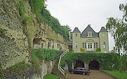 Chateau de Targe of Edouard Pisani in Saumur Champigny. The chateau is partially built in the rock using old lime stone quarry in troglodyte style, Maine et Loire France