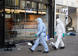 © Licensed to London News Pictures. 17/02/2019. London, UK. Police forensics at the scene on Oxford Street in central London where three people were stabbed last night. The incident took place near Tape Nightclub. Photo credit: Ben Cawthra/LNP