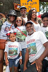 29 August 2015. Lower 9th Ward, New Orleans, Louisiana.<br /> Hurricane Katrina 10th anniversary memorials.  <br /> Cariyan Hurst (6yrs) and her grand father Robert Green, an original Rooftop Rider and survivor of the storm at a second line parade to remember those who perished and to celebrate those who survived. Green lost his mother and grand daughter to the storm. <br /> Photo credit©; Charlie Varley/varleypix.com.