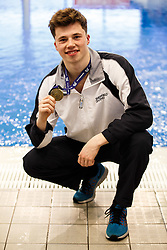 Mens 3m Springboard winner Freddie Woodward from City of Sheffield Diving Club poses with his Gold Medal - Mandatory byline: Rogan Thomson/JMP - 23/01/2016 - DIVING - Southend Swimming & Diving Centre - Southend-on-Sea, England - British National Diving Cup Day 2.