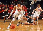 Feb. 3, 2011; Charlottesville, VA, USA; Virginia Cavaliers guard Ataira Franklin (23) picks up the loose ball in front of Wake Forest Demon Deacons guard Secily Ray (23) and Wake Forest Demon Deacons guard Mykala Walker (13) during the game at the John Paul Jones Arena. Virginia won 73-46. Mandatory Credit: Andrew Shurtleff