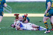 Workington Town second row Kurt Maudling (12) is tackled by Hunslet Club Parkside hooker Jamie Bradley (9)  during the Ladbrokes Challenge Cup round 3 match between Hunslet Club Parkside and Workington Town at South Leeds Stadium, Leeds, United Kingdom on 24 February 2018. Picture by Simon Davies.