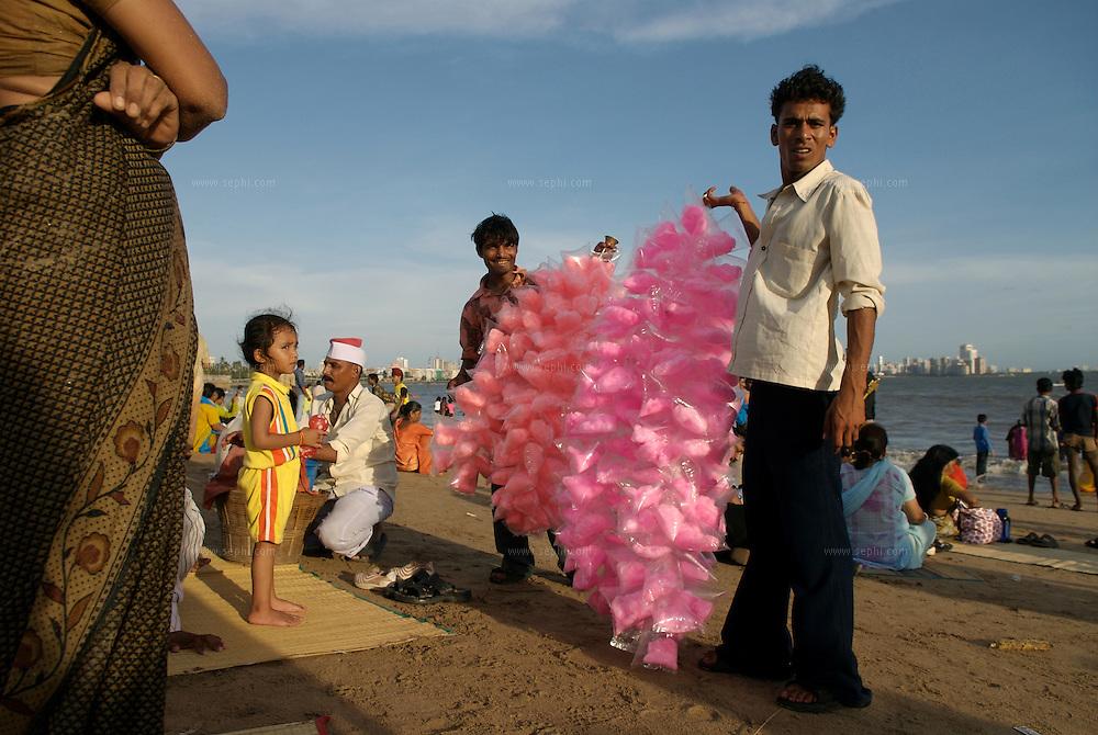 Hawkers on Chowpatti beach sell cotton sugar - 'Budia ke ball' (old woman's hair) , Mumbai, June 2007