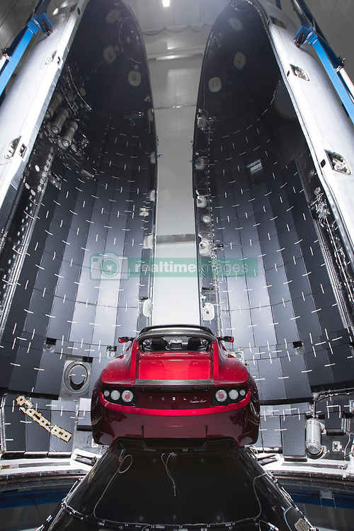 December 22, 2017 - Hawthorne, California, U.S. - Earlier this month Tesla CEO Elon Musk announced that SpaceX's Falcon Heavy will have a payload on its maiden launch that will be none other than his very own Cherry Red Tesla Roadster. Friday, Musk revealed the setup in a photo slideshow posted to Social media. The Roadster appears bright red in the center of SpaceX's slate grey rocket, called Falcon Heavy and will udergoe a billion year elliptic Mars orbit. Image Taken Dec. 5th, 2017. (Credit Image: ? Space X/ZUMA Wire/ZUMAPRESS.com)