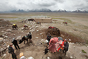 Nomads by necessity, the Kyrgyz move seasonally across Afghanistan's Pamir, a high altitude plateau stuck between China, Tajikistan and Pakistan, where the world's highest mountain ranges converge..Today, the Khan's family is leaving for their summer camp. Everything they own needs to be tied to the back of yaks, including a dozen teapots, a cast-iron stove, a car battery, two solar panels, a yurt, and 43 blankets...Moving with the Khan (chief) family from the Qyzyl Qorum camp to the summer camp of Kara Jylga, on the south side of the wide Little Pamir plateau...Trekking through the high altitude plateau of the Little Pamir mountains (average 4200 meters) , where the Afghan Kyrgyz community live all year, on the borders of China, Tajikistan and Pakistan.