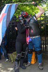 Portland Place, London, June 25th 2016. Two revellers in fetish masks pose for pictures as thousands of LGBT people and their supporters gather for Pride in London, a colourful celebration of the hard-won rights of lesbian, gay, bisexual and transgender  people.