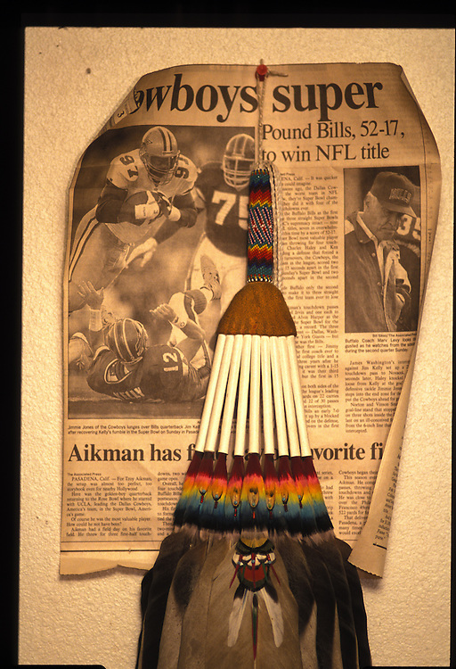 A prayer fan used to direct smoke to a suppilicant's body, hangs in the harvey family's home.