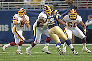 Washington Redskins' Derrick Dockery (66) and Chris Samuels (60) give quarterback Mark Brunell (8) pass protection from on rushing St. Louis Rams defensive tackle Damione Lewis (92) in the first half, at the Edward Jones Dome in St. Louis, Missouri, December 4, 2005.  The Redskins beat the Rams 24-9.