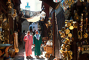 MOROCCO, FEZ the medina, colorful, crowded, narrow  lanes lined with shops selling all types  of traditional craft items