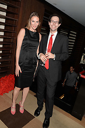 JOSH SPERO and LAETITIA CASH at a party to celebrate Ben Goldsmith guest-editing the July/August 2013 edition of Spears Magazine held at 45 Park Lane, London on 19th June 2013.