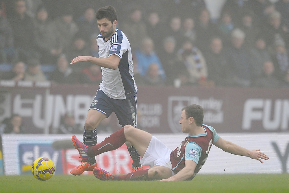 Burnley's Ashley Barnes battles with  West Bromwich Albion's Claudio Yacob<br /> <br /> Photographer Dave Howarth/CameraSport<br /> <br /> Football - Barclays Premiership - Burnley v West Bromwich Albion - Sunday 8th February 2015 - Turf Moor - Burnley<br /> <br /> © CameraSport - 43 Linden Ave. Countesthorpe. Leicester. England. LE8 5PG - Tel: +44 (0) 116 277 4147 - admin@camerasport.com - www.camerasport.com