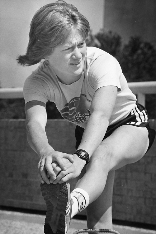 ©1987  high school track athlete stretching before a race, no ID