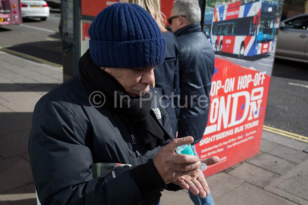 On the day that the UK Governments Chief Scientific Advisor, Sir Patrick Vallance said that the Coronavirus Covid-19 outbreak was now spreading person to person in the UK, a Londoner just emerged from the Central Line, squeezes some hand gel onto his hands outside Green Park underground station on Piccadilly, on 6th March 2020, in London, England.