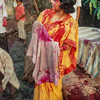 Middle class college students tossed dye colored ballons as they celebrate the Hindu holiday Holi in Dhaka, Bangladesh, 1977.