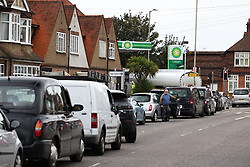 © Licensed to London News Pictures. 05/10/2021. Waltham Abbey, UK. Tragic queues for fuel while a fuel tanker fills a petrol station in Waltham Abbey. Military personnel have started helping with driver shortages following more than a week of long queues and closures at petrol stations. Photo credit: Ben Cawthra/LNP