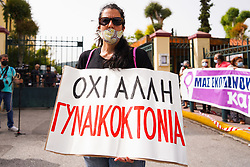 © Licensed to London News Pictures. 22/06/2021. Athens, Greece. A protester holds a banner that reads ''No more femicide as she takes part in a protest outside the court in Athens.. The 33-year-old helicopter pilot and flight instructor Babis Anagnostopoulos has been detained as a suspect in the murder of his British wife Caroline Crouch, 20, outside Athens last month after publicly claiming she'd been killed during a brutal invasion of the couple's home, police said. Photo credit: Ioannis Alexopoulos/LNP