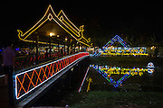 A traditional wooden bridge over Siem Reap River leading to the Siem Reap Art Centre Night Market lit-up and decorated in neon lights.  The market sells souvenirs, art work and carvings. The market opened in 2012.  (photo by Andrew Aitchison / In pictures via Getty Images)