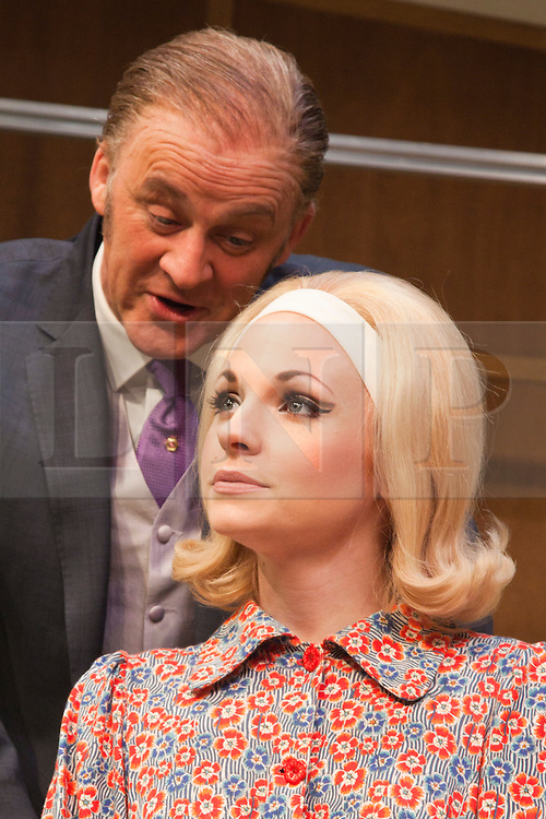 © Licensed to London News Pictures. 09/05/2012. London, England. Tim McInnerny as Dr Prentice and Georgia Moffett as Geraldine Barclay. What the Butler Saw by Joe Orton and directed by Sean Foley opens at the Vaudeville Theatre, London. Photo credit: Bettina Strenske/LNP