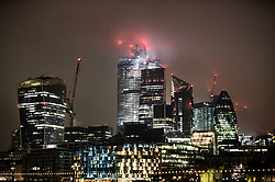 © Licensed to London News Pictures. 21/01/2019. London, UK. Low clouds over the sky scrapers in The City of London denied stargazers sight of the full super wolf moon during it's blood red eclipse period. The first full moon of 2019 is a super moon as it appears brighter and it passes much closer to earth. Photo credit: Peter Macdiarmid/LNP