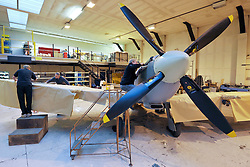 "© Licensed to London News Pictures. File picture dated 13/12/2012. Bristol, UK. Engineers race to finish work rebuilding a Mark IX Spitfire fighter circa 1943, at Filton airfield near Bristol. The plane has been rebuilt  by John Hart engineering, it is the last plane to be completed at the airfield and was flown out on 18 December 2012 by pilot Bill Perrins. Filton, the birthplace of the British-built Concorde jets, is to close on Friday (21st December 2012). Its owner BAE Systems says it is not viable and intends to sell it for housing and business development. BAE Systems said the airfield was closing following a comprehensive assessment over a five-year period and an independent review, ""both of which concluded that the airfield was not economically viable"".  Airbus has said it is fully committed to the Filton site, where it has a base making aircraft wings.  A spokesman said: ""The closure of the airfield will have no significant effect on our business and we have mitigation plans in place regarding the change of venue for our passenger shuttle (using Bristol airport) and the transportation of the A400M wings (via Portbury docks).  Planes currently based at Filton will have to find new homes. The airfield officially closes for flights this Friday, though the police helicopter will still be based there. BAE is supporting a new museum at Filton to ""house Concorde Alpha-Foxtrot and Bristol's aviation heritage."".Photo credit : Simon Chapman/LNP"