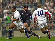 Twickenham. Surrey. UK England vs New Zealand, Autumn Internationals.<br /> <br /> 09/11/2002<br /> International Rugby England vs New Zealand<br /> Jason Robinson runs after recieving the high kicked ball. [Mandatory Credit Peter SPURRIER/Intersport Images]