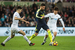 SWANSEA, WALES - Saturday, January 14, 2017: <br /> Arsenal's Oliver Giroud in action against Swansea City Ki Sung-Yueng during the FA Premier League match at the Liberty Stadium. (Pic by Gwenno Davies/Propaganda)