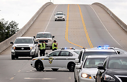 October 8, 2016 - Isle Of Palms, SC, USA - Isle of Palms, S.C., police officers check drivers coming onto the island for proof of residency on Saturday, Oct. 8, 2016, as wind, rain and flooding from Hurricane Matthew struck the area. (Credit Image: © Jeff Siner/TNS via ZUMA Wire)