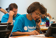 Volunteers from CenterPoint Energy work a phone bank at Houston ISD's Hattie Mae White building to update information on students that have not registered for school in an effort for dropout prevention, September 4, 2013.