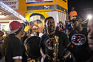 Brass band joins a protest after a vigil for Alton Sterling at the Triple S Food Mart, Wednesday, July 6, 2016.