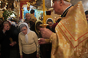 Moscow, Russia, 06/01/2011..Father Vasili waves incense and blesses parishioners as Russian Christians attend an Orthodox Christmas service at Peter Paul church in central Moscow, late on Christmas Eve. Christmas falls on January 7 for Orthodox believers in the Holy Land, Russia and other Orthodox churches that use the old Julian calendar instead of the16th-century Gregorian calendar.