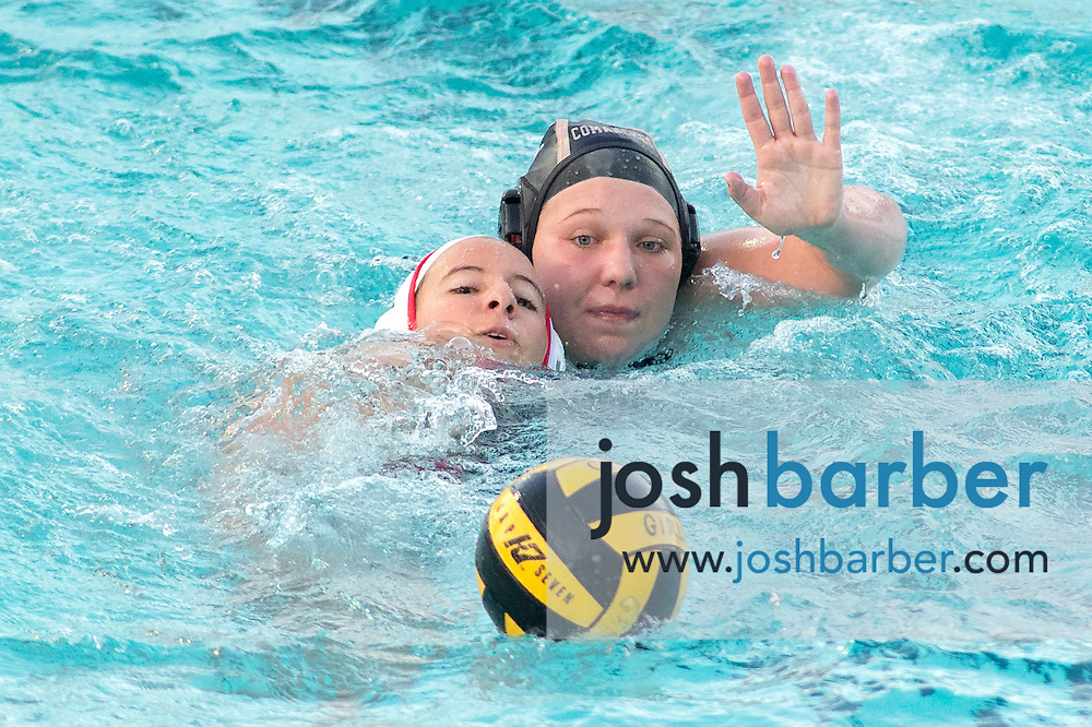 Troy's Alex Dowell (18), Canyon's Madison Weber (7) during nonleague girls water polo at Canyon High School on Friday, January 8, 2016 in Anaheim, California. Troy won 14-6. (Photo/Josh Barber)