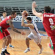 Anadolu Efes's Dogus Balbay (C) during their Turkish Basketball League Play Off match Anadolu Efes between Pinar Karsiyakaat Sinan Erdem Arena in Istanbul, Turkey, Sunday, May 06, 2012. Photo by TURKPIX