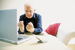 Dec. 14, 2012 - Man using laptop computer (Credit Image: © Image Source/ZUMAPRESS.com)