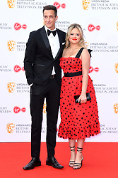 Rob Jowers and Emily Atack attending the Virgin Media BAFTA TV awards, held at the Royal Festival Hall in London. Photo credit should read: Doug Peters/EMPICS