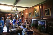 Tourists inside the library room at Sissinghurst castle gardens, Kent, England, UK