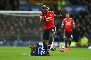 Tom Davies of Everton is fouled by Paul Pogba of Manchester United. Premier league match, Everton v Manchester Utd at Goodison Park in Liverpool, Merseyside on New Years Day, Monday 1st January 2018.<br /> pic by Chris Stading, Andrew Orchard sports photography.